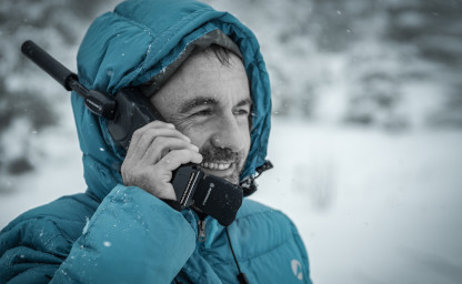image of man using satellite phone